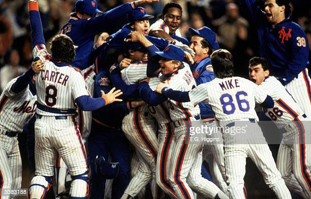 The New York Mets celebrate after winning game 7 of the 1986 World Series against the Boston Red Sox at Shea Stadium on October 27 1986 in Flushing...