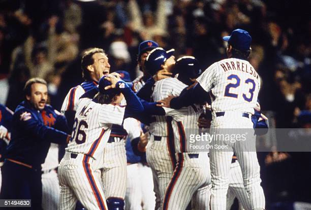 The New York Mets celebrate after winning Game Seven of the World Series against the Boston Red Sox at Shea Stadium on October 27 1986 in Flushing...