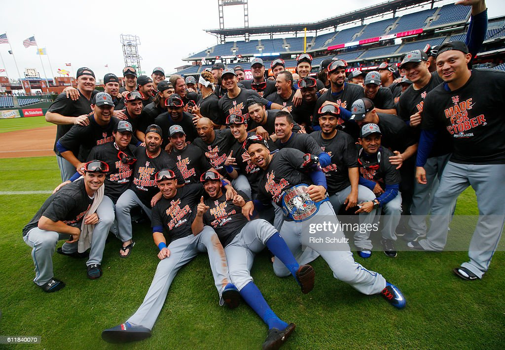 The New York Mets celebrate pose for a photo after they defeated the Philadelphia Phillies 5-3 during a game at Citizens Bank Park on October 1, 2016 in Philadelphia, Pennsylvania. The win clinched a Wild Card game for the Mets.