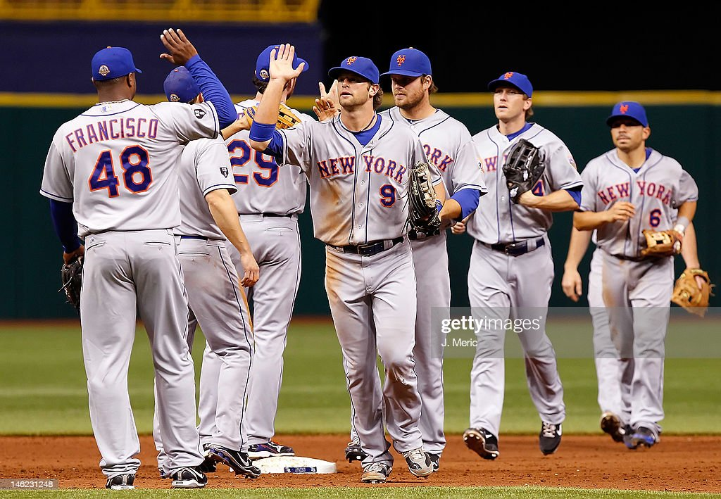 The New York Mets celebrate their victory over the Tampa Bay Rays at Tropicana Field on June 12, 2012 in St. Petersburg, Florida.