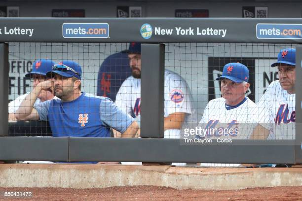 The new York Mets coaching staff watching play from left Dan Warthen of the New York Mets Kevin Long of the New York Mets Manager Terry Collins of...