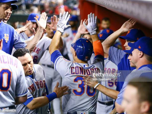 The New York Mets dugout congratulates New York Mets left fielder Michael Conforto after hitting a homer during the MLB baseball game between the...