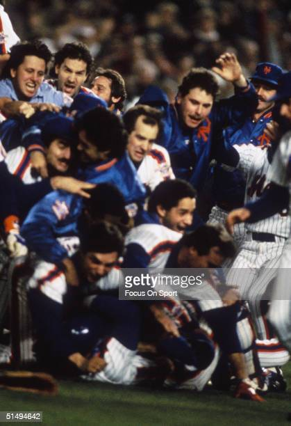 The New York Mets pile on each other in celebration after defeating the Boston Red Sox in Game Seve of the World Series at Shea Stadium on October...