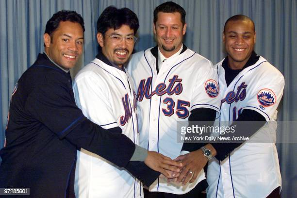 The New York Mets show off four of their new players Roberto Alomar Satoru Komiyama Mark Guthrie and Roger Cedeno at a press conference at Shea...