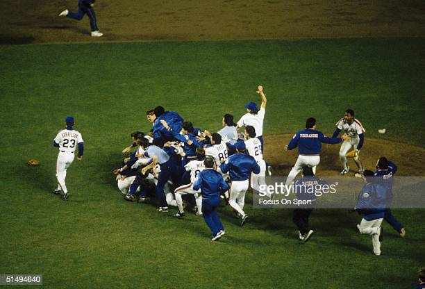 The New York Mets spill onto the field as the celebration begins after defeating the Boston Red Sox in Game Seven of the World Series at Shea Stadium...