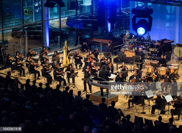 The New York Philharmonic Orchestra under direction of Alan Gilbert perform at the VW Transparent Factory in Dresden Germany 14 May 2013 In the piece...
