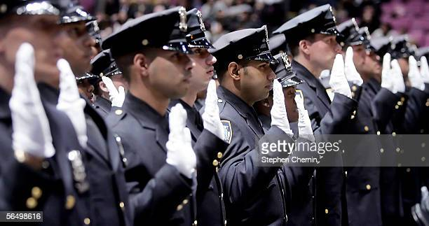 The New York Police Department's Class of 2005 raise their right hands as they take their oath during their graduation from the NYPD Police Academy...