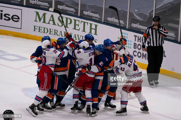 The New York Rangers and New York Islanders fight during the second period of the National Hockey League game between the New York Rangers and the...