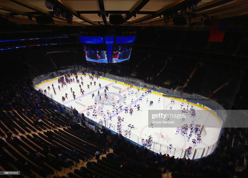The New York Rangers and the Montreal Canadiens skate during warmups at Madison Square Garden on November 25, 2015 in New York City.