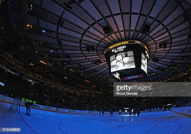 The New York Rangers and the Pittsburgh Penguins hold a moment of silence for Bill Gatsby prior to their game at Madison Square Garden on March 13...
