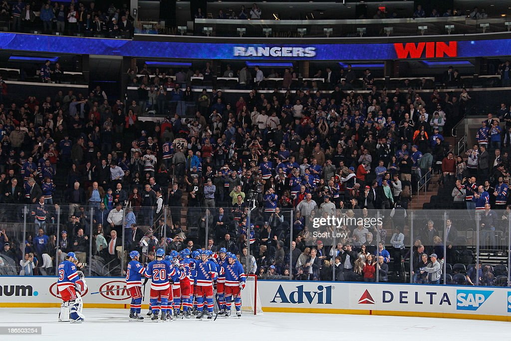 The New York Rangers celebrate a 2-0 win against the Buffalo Sabres at Madison Square Garden on October 31, 2013 in New York City.