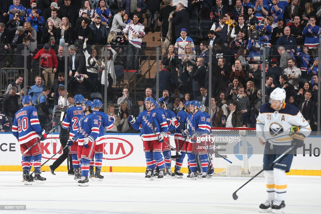 The New York Rangers celebrate a 4-3 win against the Buffalo Sabres at Madison Square Garden on January 18, 2018 in New York City.