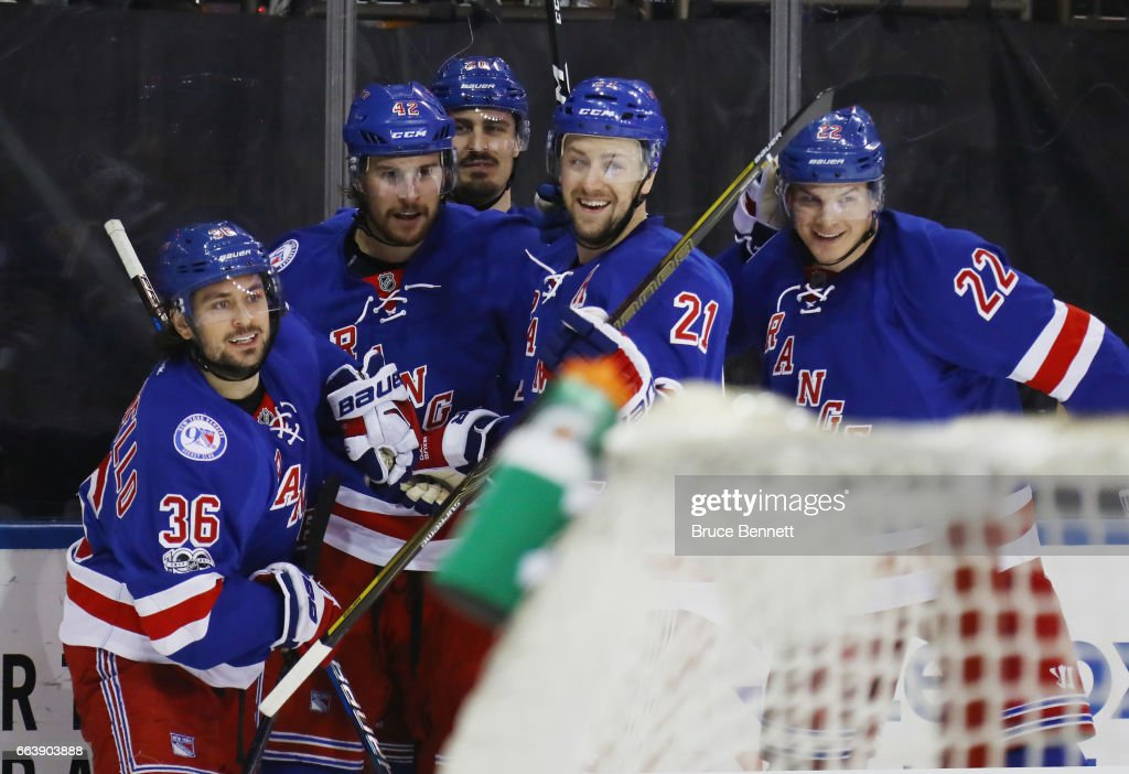 The New York Rangers celebrate a goal by Brendan Smith #42 (2nd from left) against the Philadelphia Flyers at Madison Square Garden on April 2, 2017 in New York City. The Rangers defeated the Flyers 4-3.