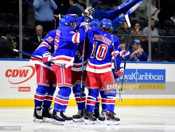The New York Rangers celebrate a goal in the second period by Artemi Panarin during their game against the Washington Capitals at Madison Square...