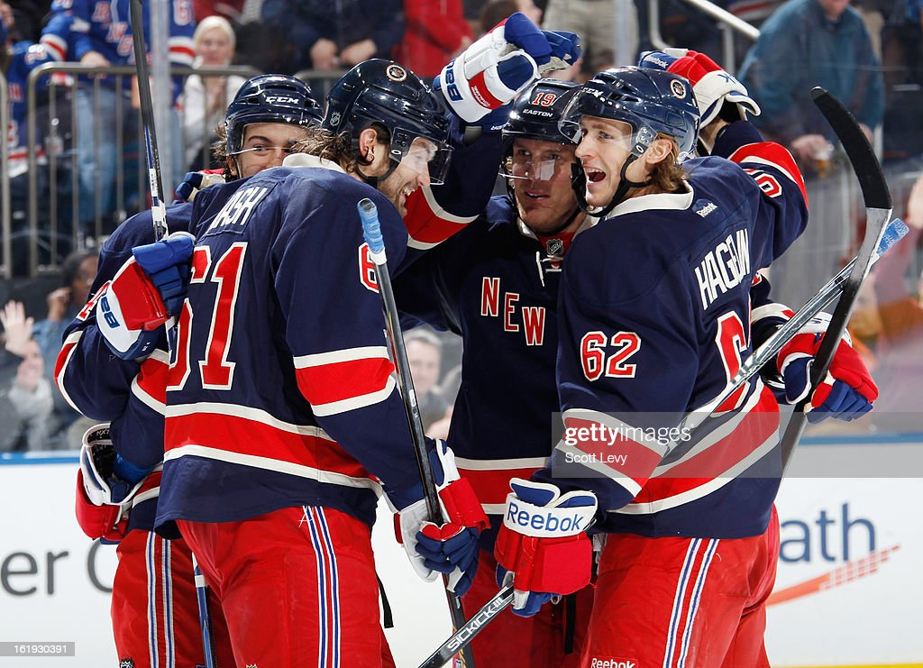 The New York Rangers celebrate a third period goal against the Washington Capitals at Madison Square Garden on February 17, 2013 in New York City. The Rangers defeat the Capitals 2-1.
