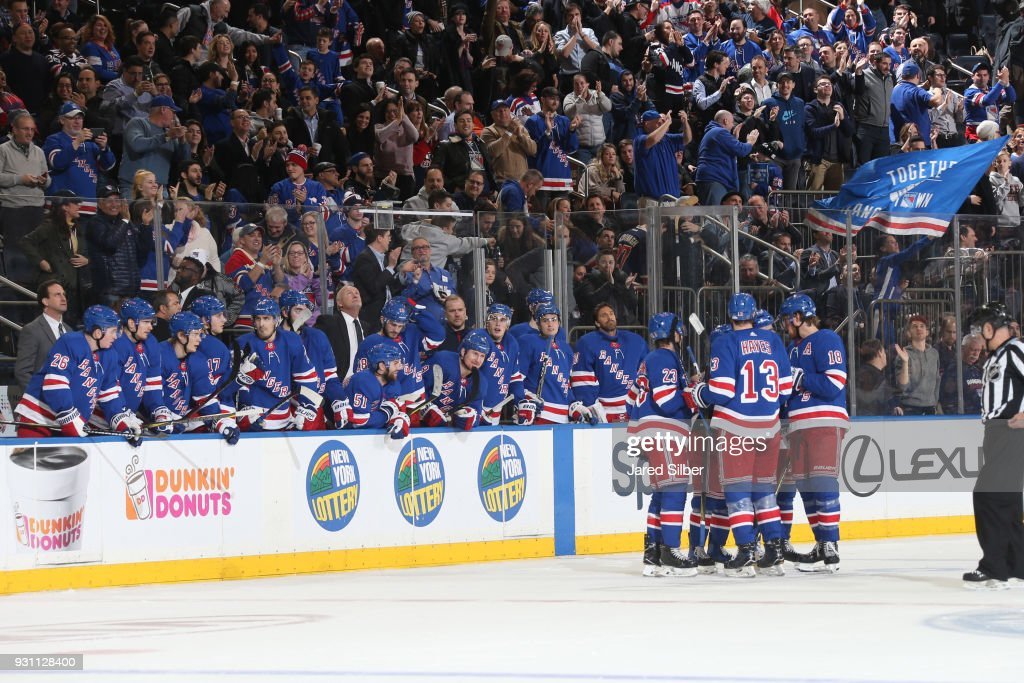The New York Rangers celebrate after a goal in the third period against the Carolina Hurricanes at Madison Square Garden on March 12, 2018 in New York City.