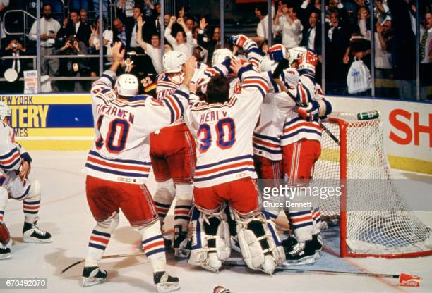 The New York Rangers celebrate after defeating the Vancouver Canucks in Game 7 of the 1994 Stanley Cup Finals on June 14 1994 at Madison Square...