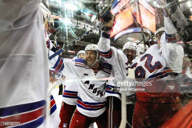 The New York Rangers celebrate after Marian Gaborik scored the game winning goal in the third overtime period against the Washington Capitals in Game...