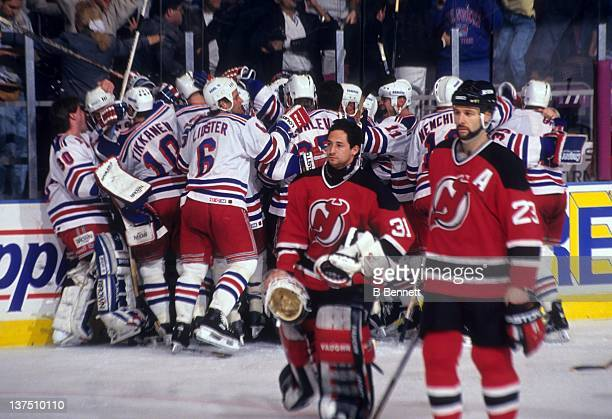 The New York Rangers celebrate after Stephane Matteau scored the winning goal in the second overtime of Game 7 of the 1994 Eastern Conference Finals...