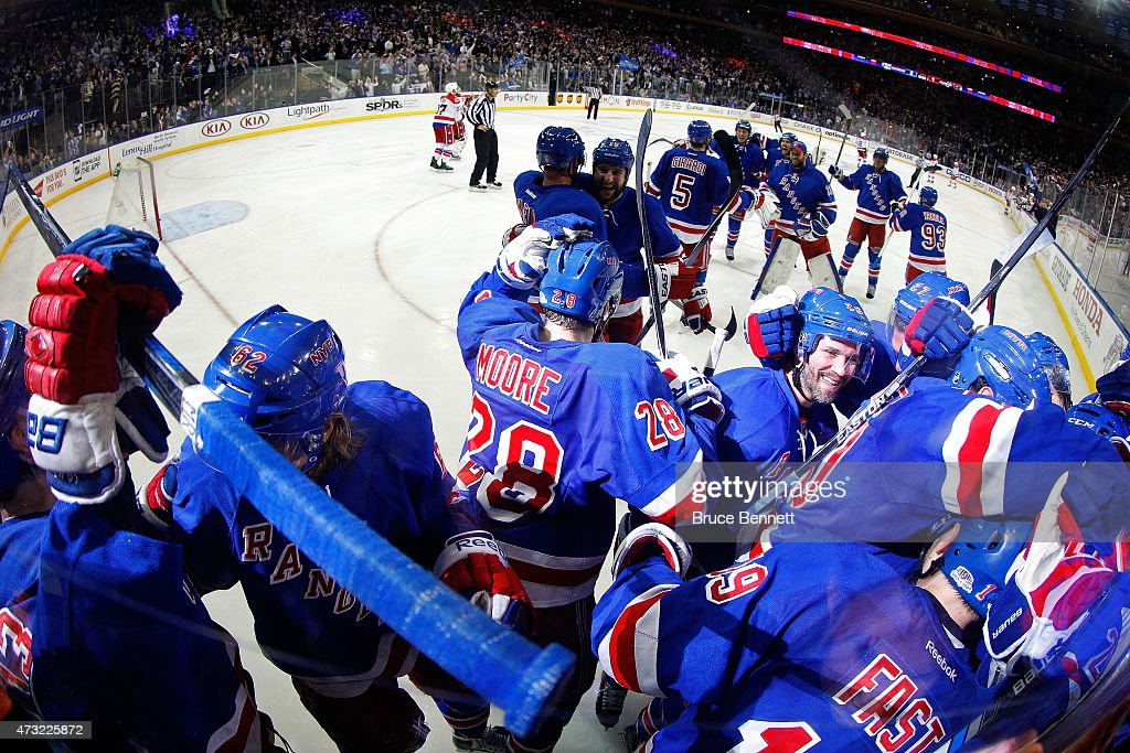The New York Rangers celebrate after winning Game Seven of the Eastern Conference Semifinals against the Washington Capitals on a game winning goal scored by Derek Stepan #21 of the New York Rangers during the 2015 NHL Stanley Cup Playoffs at Madison Square Garden on May 13, 2015 in New York City.