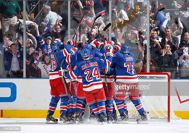 The New York Rangers celebrate the win against the Washington Capitals in Game Seven of the Eastern Conference Semifinals during the 2012 NHL Stanley...
