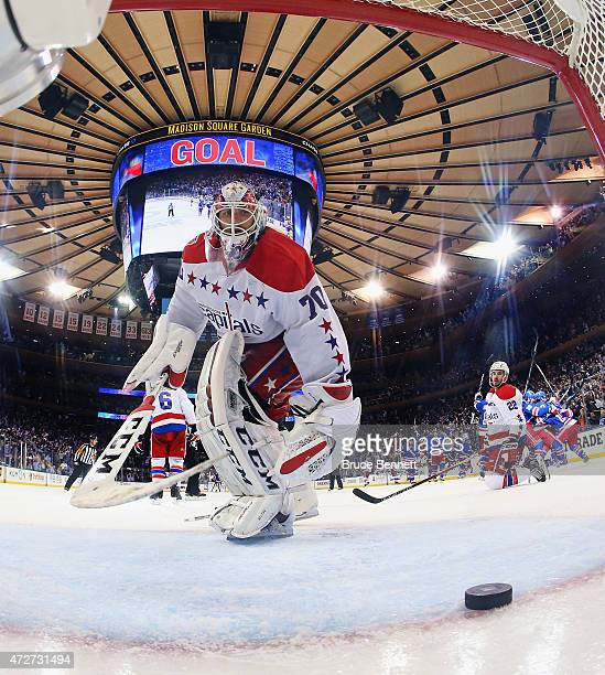 The New York Rangers celebrate their 21 overtime victory over the Washington Capitals as Braden Holtby fishes the puck out of the net in Game Five of...