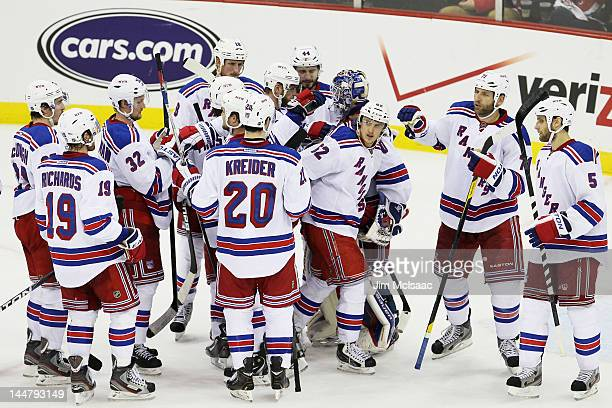 The New York Rangers celebrate their 3 to 0 win over the New Jersey Devils in Game Three of the Eastern Conference Final during the 2012 NHL Stanley...