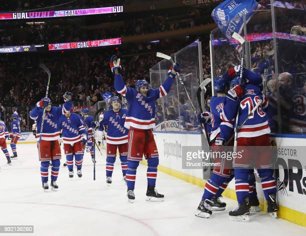 The New York Rangers celebrate their overtime victory over the Pittsburgh Penguins at Madison Square Garden on March 14 2018 in New York City The...