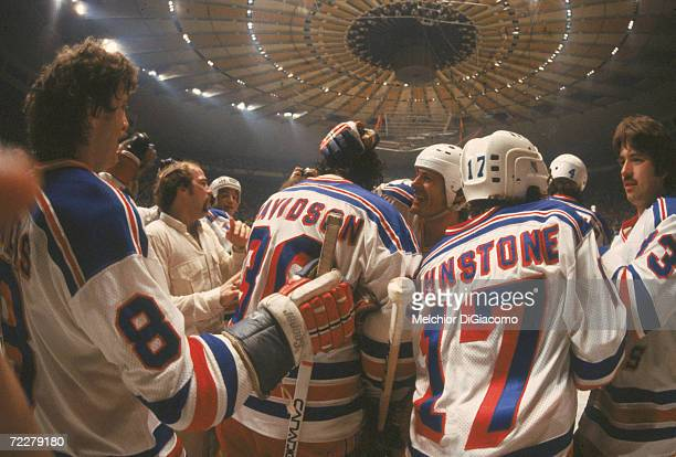 The New York Rangers celebrate their playoff victory over the New York Islanders on the ice at Madison Square Garden, New York, New York, 1979....