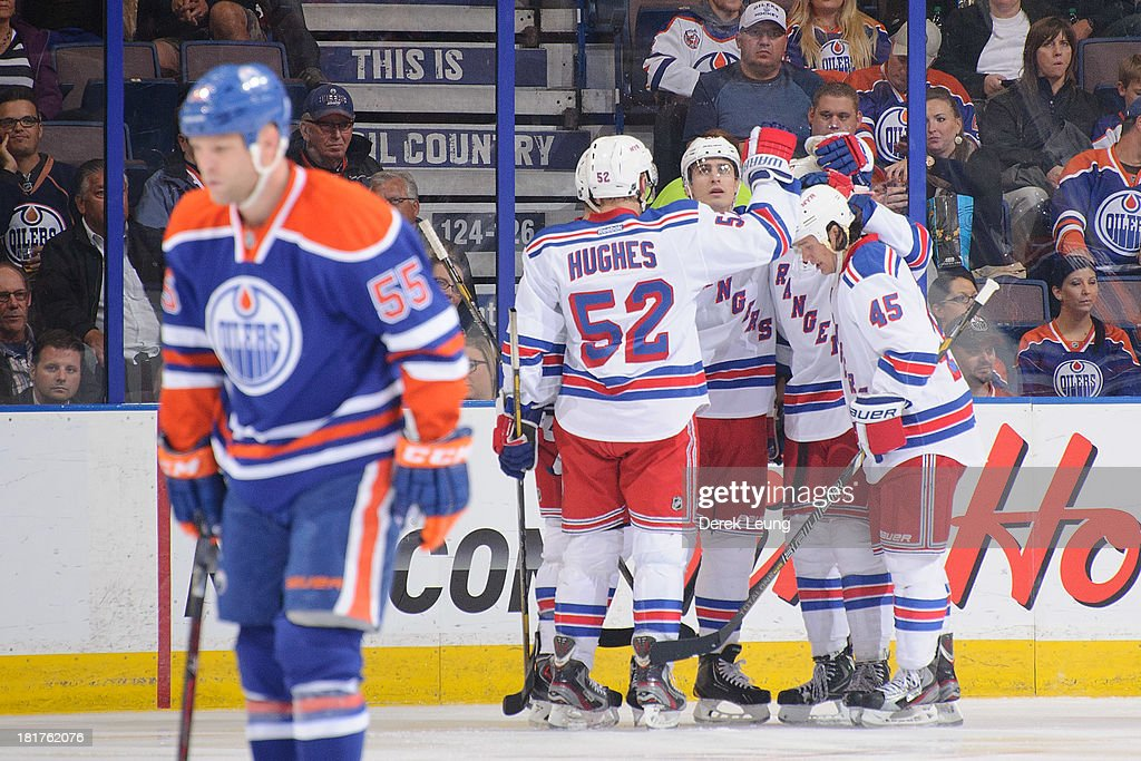 The New York Rangers celebrate their second period goal scored by J.T. Miller #10 while a dejected Ben Eager #55 of the Edmonton Oilers skates away during a preseason NHL game at Rexall Place on September 24, 2013 in Edmonton, Alberta, Canada.