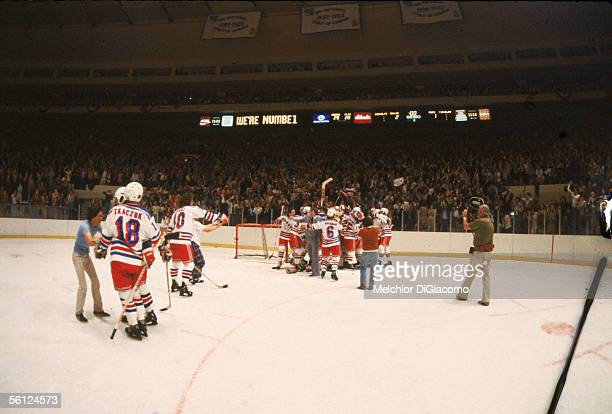 The New York Rangers celebrate their victory over the rival NY Islanders in Game 6 of the Campbell Conference playoffs at Madison Square Garden New...