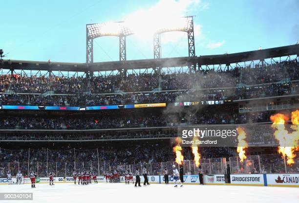 The New York Rangers celebrate winning the 2018 Bridgestone NHL Winter Classic y defeating the Buffalo Sabres 32 in overtime at Citi Field on January...