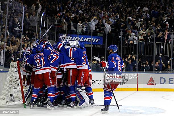 The New York Rangers celebrates after defeating the Montreal Canadiens in Game Six to win the Eastern Conference Final in the 2014 NHL Stanley Cup...