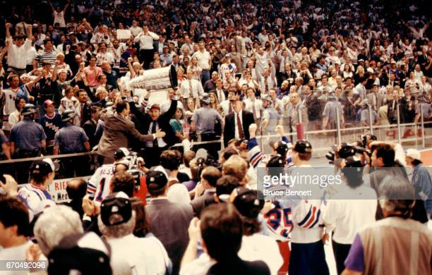 The New York Rangers coaches celebrate with the Stanley Cup Trophy after defeating the Vancouver Canucks in Game 7 of the 1994 Stanley Cup Finals on...