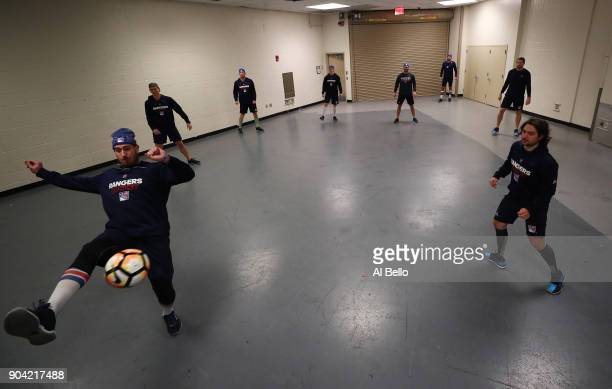 The New York Rangers play with a soccer ball prior to their game against the New Jersey Devils at Madison Square Garden on December 9 2017 in New...