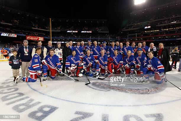 The New York Rangers pose for a team photo after the game against the Philadelphia Flyers at Citizens Bank Park during the 2012 Bridgestone NHL...