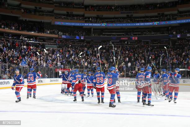 The New York Rangers salute the crowd after defeating the Edmonton Oilers 42 at Madison Square Garden on November 11 2017 in New York City