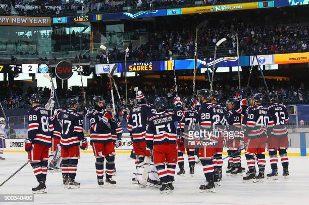 The New York Rangers salute the fans after the 2018 Bridgestone NHL Winter Classic at Citi Field against the Buffalo Sabres on January 1 2018 in New...