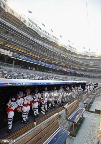 The New York Rangers wait in the dugout for their practice ice to be ready the day before their outdoor game against the New Jersey Devils at Yankee...