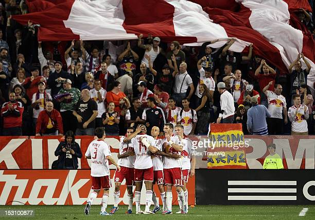 The New York Red Bulls celebrate their final goal against Toronto FC at Red Bull Arena on September 29, 2012 in Harrison, New Jersey.