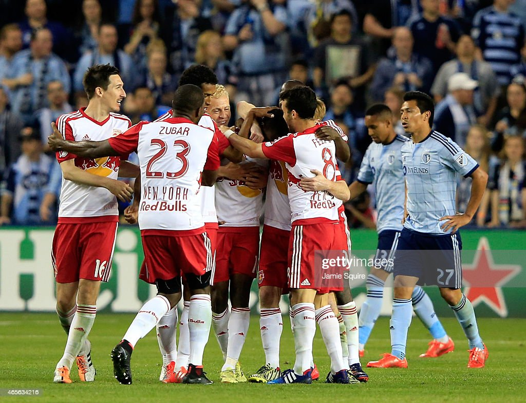 The New York Red Bulls congratulate Lloyd Sam #10 after Sam scored during the game against Sporting KC at Sporting Park on March 8, 2015 in Kansas City, Kansas.