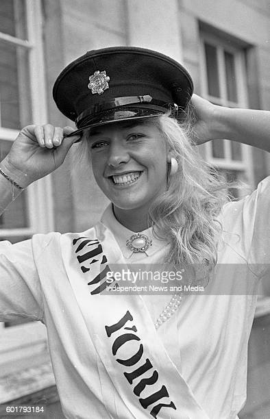 The New York Rose Kelly Moran a member of the New York Police Departmant tries on a Garda Cap when the Roses visited Leinster House