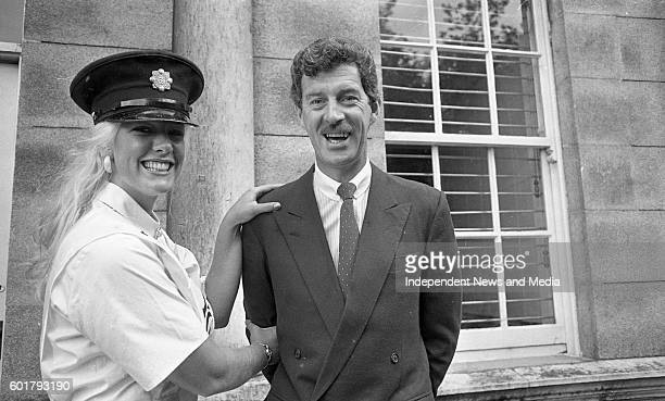 The New York Rose Kelly Moran a member of the New York Police Departmant tries on a Garda Cap when the Roses visited Leinster House also in the...