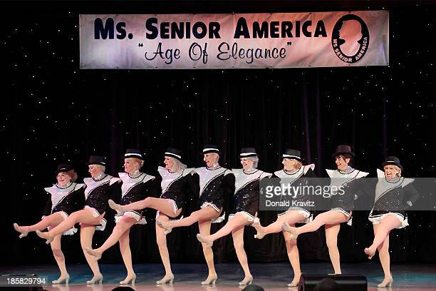 The New York Seasoned Steppers of former contestants perform a Rockettes style line dance as they attend the Ms Senior America 2013 pageant at...