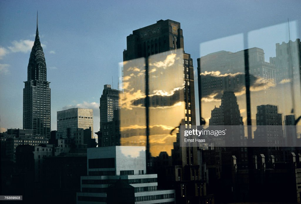 The New York skyline at sunset, with the Chrysler Building on the left, 1957.