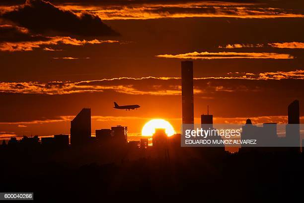 TOPSHOT The New York skyline is seen at sunset the USTA Billie Jean King National Tennis Center on Day 10 of the US Open tennis tournament in New...