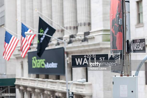 The New York Stock Exchange behind a Wall Street street sign on Thursday, January 20, 2016. Weakness in China and plummeting oil prices are pulling...