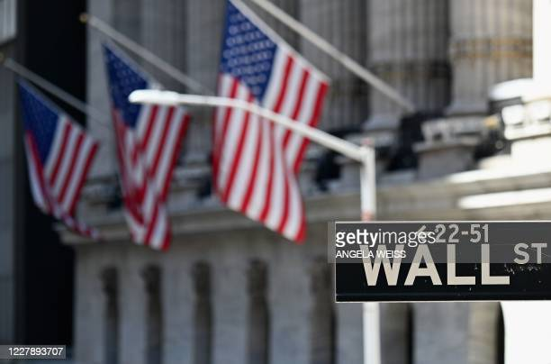 The New York Stock Exchange is pictured on August 3, 2020 at Wall Street in New York City. - Stock markets rose on both sides of the Atlantic August...