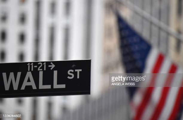 The New York Stock Exchange is pictured on August 31, 2020 at Wall Street in New York City. - Wall Street stocks paused near record levels early...