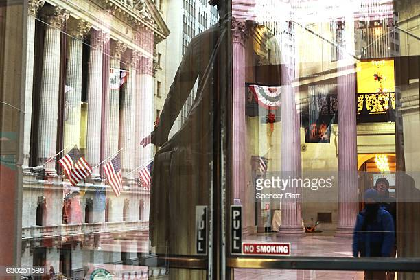 The New York Stock Exchange is reflected in a window on December 19 2016 in New York City Markets rose modestly in morning trading as the Dow Jones...